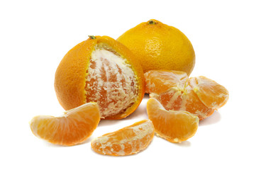 close up of fresh orange mandarin and wedges isolated over whit