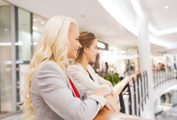 happy young women in mall or business center