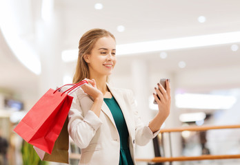 woman with smartphone shopping and taking selfie