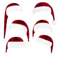 Set of red Santa Claus hats isolated on white