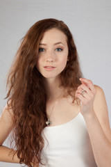 Woman with long hair looking thoughtfully at the camera