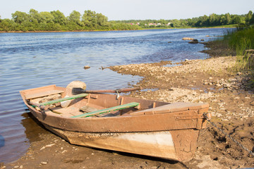 Old wooden boat at the riverside