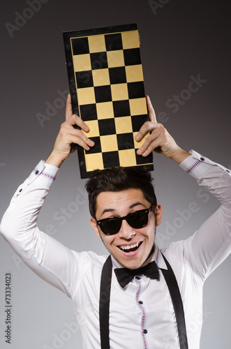 Funny Chess Player With Board Stock Photo And Royalty
