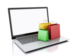 3d Laptop and colorful Shopping Bags. E-commerce concept