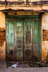 Vintage old door with brick wall