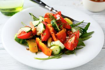 Fresh salad with tomatoes, cucumbers and arugula