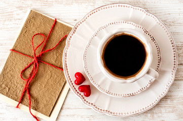 Valentine's day tea set with cup of coffee and greeting card