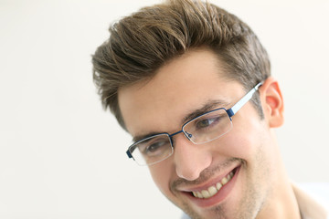Portrait of young man wearing eyeglasses, isolated