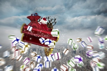 Composite image of white christmas presents with ribbon