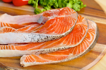 Delicious  portion of fresh salmon fillet with vegetables on