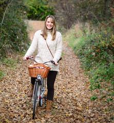 Beautiful woman enjoying nature driving bicycle