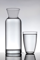 glass and a carafe filled with water