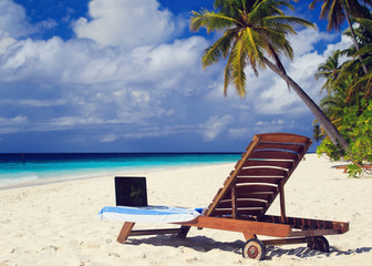 laptop on chair in tropical vacation