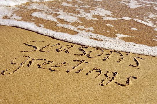 seasons greetings on the beach
