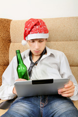 Teenager with a Beer and Tablet