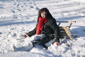 Woman playing and enjoying with sledges