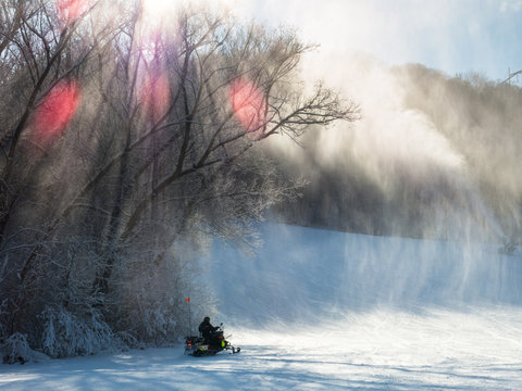 Ski patrol on snowmobile at a ski-field