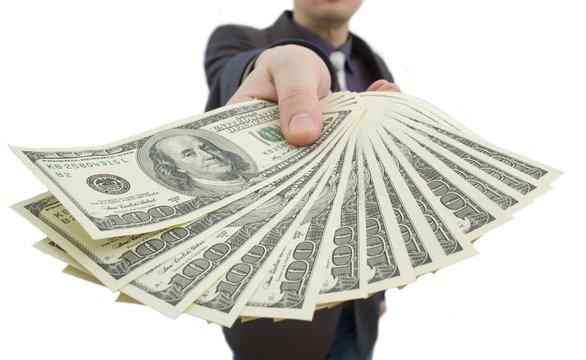 Man holding a hundred dollar bill