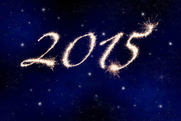 2015 in fireworks against the night sky with stars.