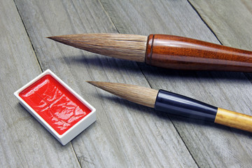 asian writing brushes and ink for calligraphy on wood
