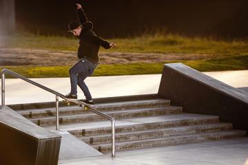 Boy doing skateboard trick in skatepark