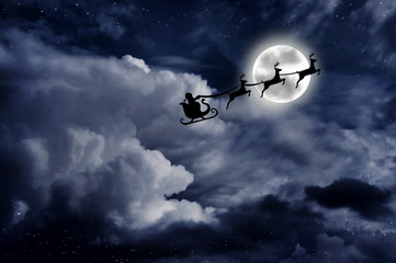 Santa on a sleigh with rein deers over the full moon