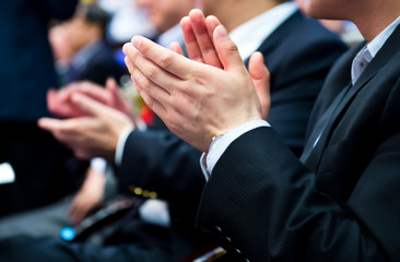applauding at meeting
