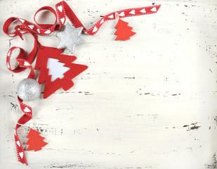 Red and white Christmas ornaments on vintage white wood