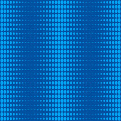 Vertical halftone of blue oval dots on a blue background