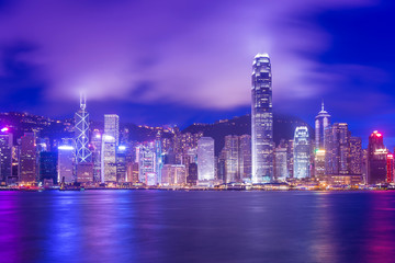 Hong Kong Victoria Harbour cityscape at night.