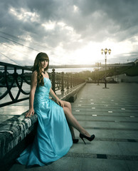 Attractive girl in long evening dress