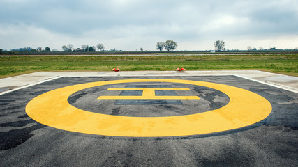 Helicopter sign in landing area.