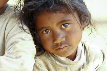 Poverty, portrait of a poor little African girl lost in deep tho Fotomurales