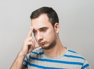Depressed young man  holding head in hands