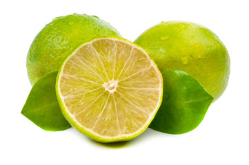 limes and slice with leaves isolated