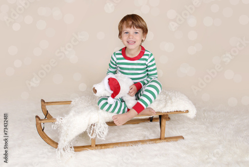 ff5364c0cd Winter Holidays  Laughing Happy Child in Christmas Pajamas Sled ...