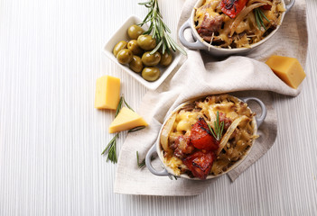 Pasta baked with vegetables and cheese in ceramic pot