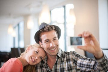 trendy Couple taking a Selfie with a phone