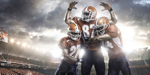American football players in action on stadium Wall mural