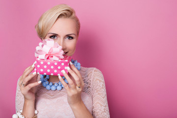 Happy birthday. Blonde woman holding small gift box with ribbon