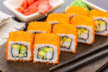 Sushi roll with tobico and avocado