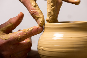 potter, creating an earthen jar