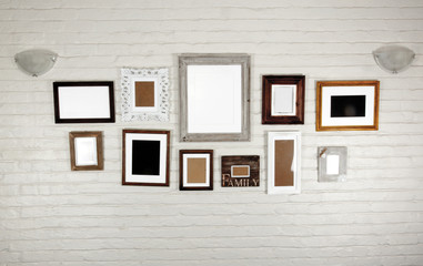 Empty Frames and Lamps on White Bagged Wall