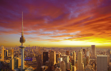 In de dag Rood traf. Kuwait cityscape during the sunset