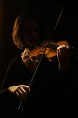 Violin player violinist. Orchestra musical instruments concert