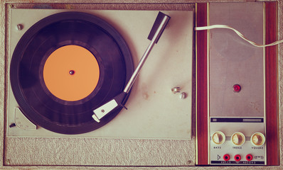 top view of old record player, image is retro filtered