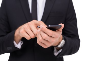 Mid section of a businessman using smartphone