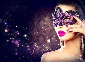 Foto op Aluminium Carnaval Sexy woman wearing carnival mask over holiday dark background