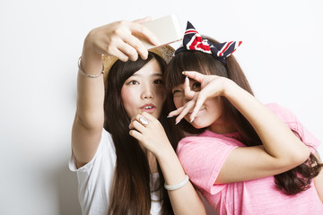 Two smiling asian girls