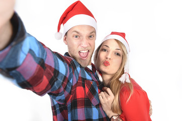 young couple taking Christmas love selfie mobile portrait